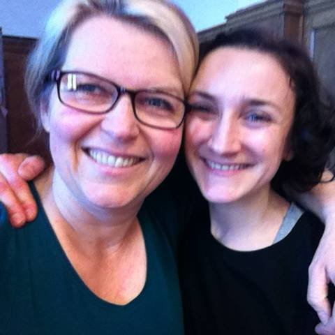 Angela, our Director and Louise, our ex-dance teacher, cuddle up for a selfie. They smile and look into the camera. Both dressed in dark tops.